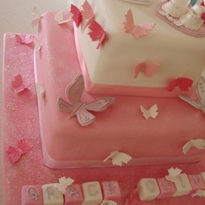 Twin booties christening cake