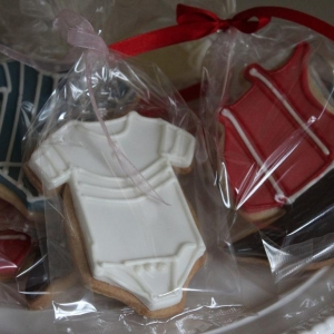 Red and white baby grow cookies