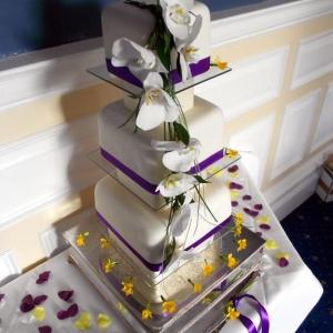 Fresh orchid wedding cake