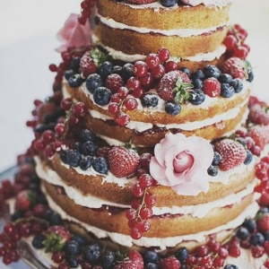 Naked berry and roses wedding cake