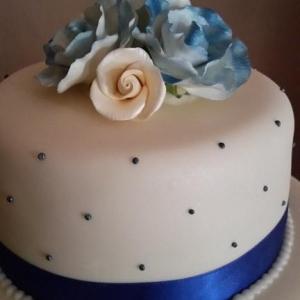 Navy and cream roses wedding cake