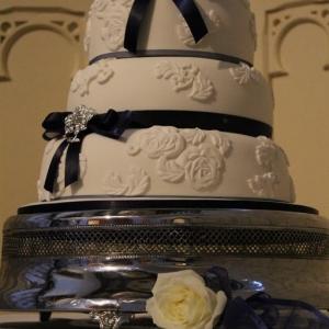 Navy and white lace wedding cake
