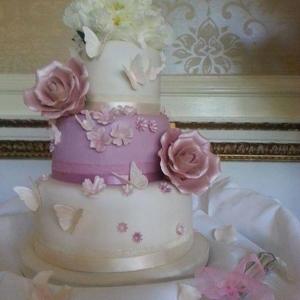 Pink rose and blossom wedding cake
