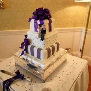 Purple bow and stripes wedding cake