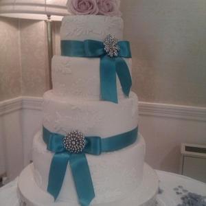 Turquoise and lace wedding cake